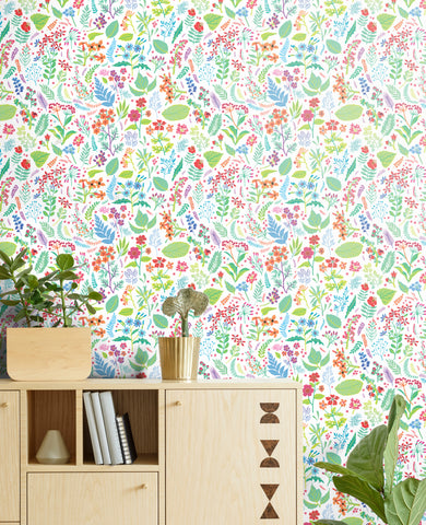 Bright, vivid flower and plant removable wallpaper behind a Scandinavian modern credenza