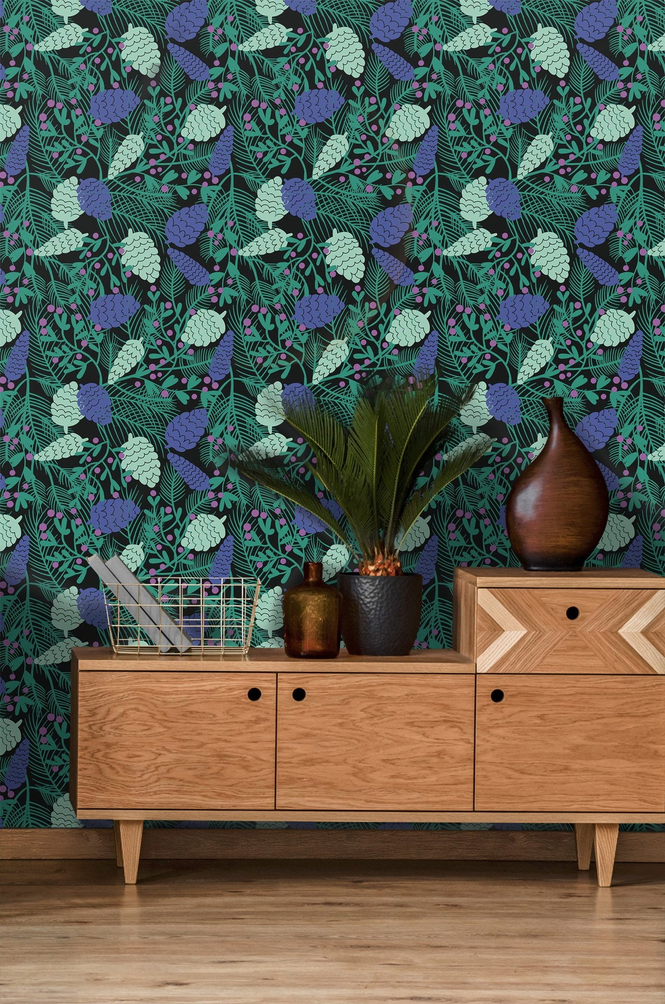 Removable wallpaper of pine cones, needles and berry plants behind credenza