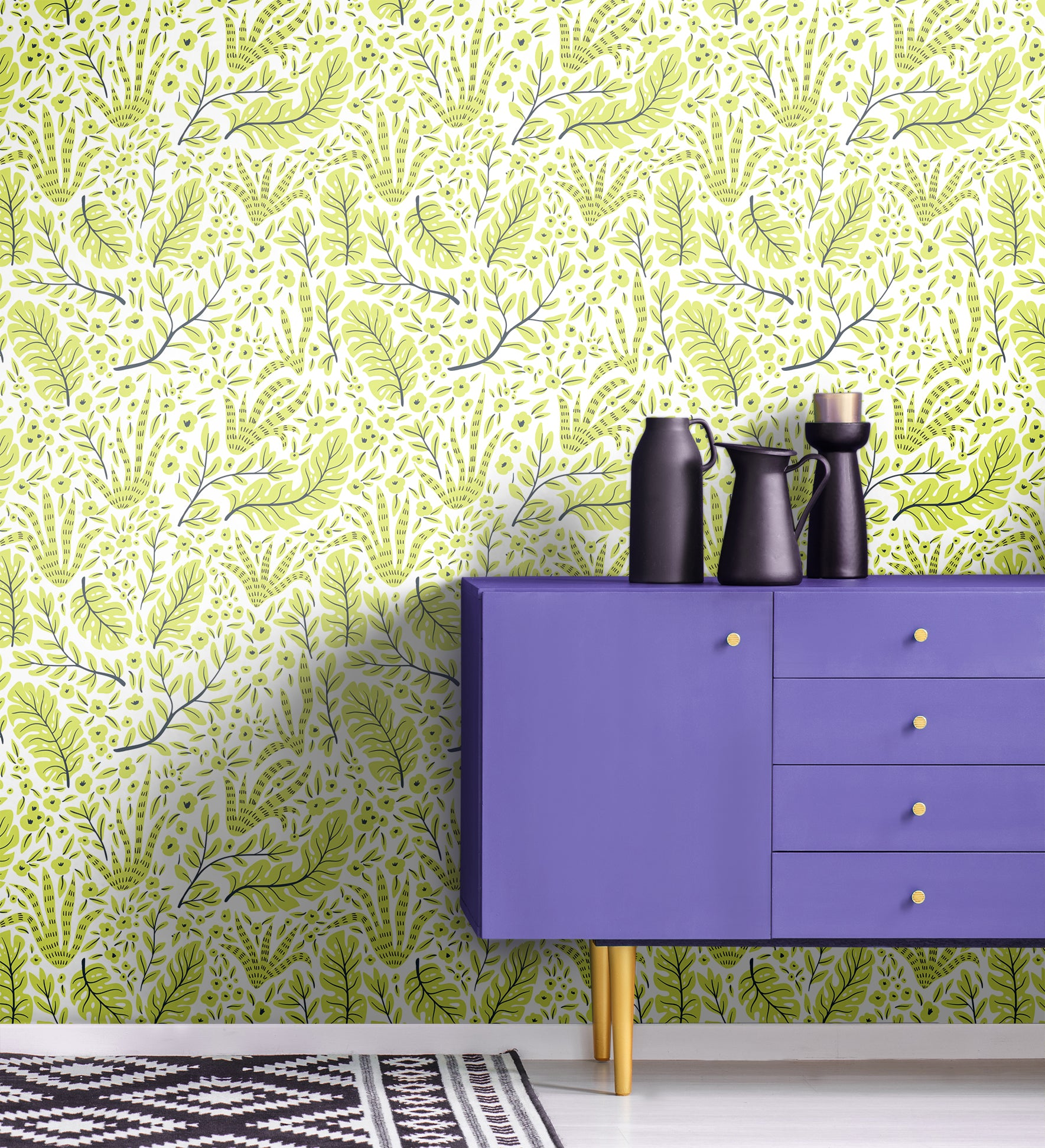 Bright, vivid tropical plant removable wallpaper behind purple credenza and kilim rug