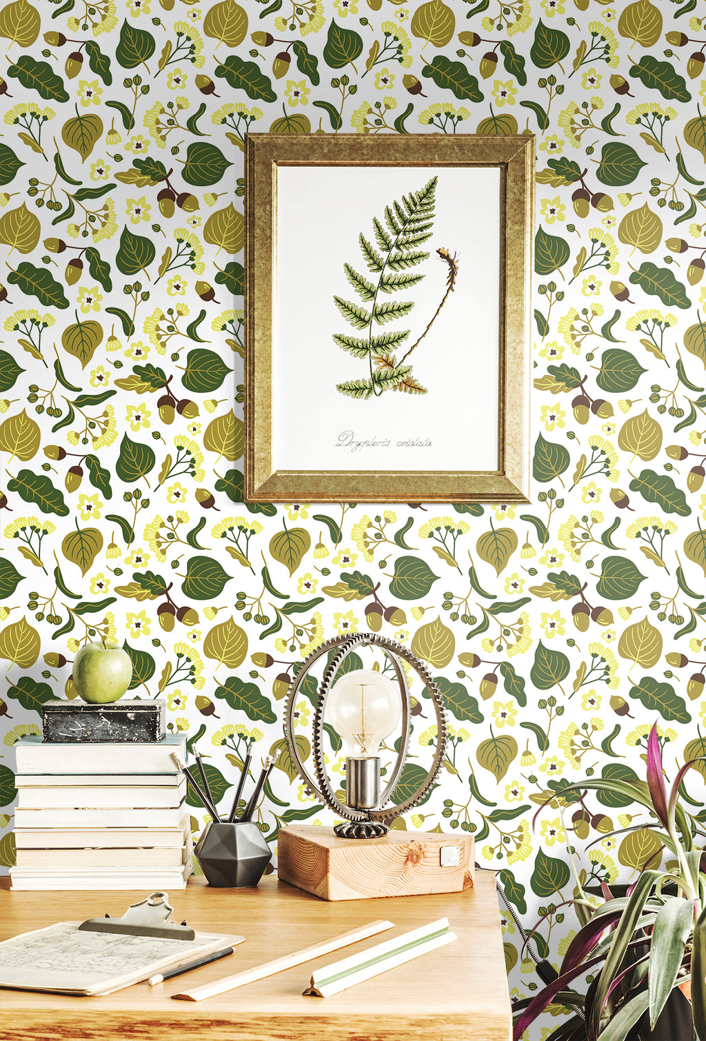 Vivid natural plant removable wallpaper behind a writing desk with papers and books