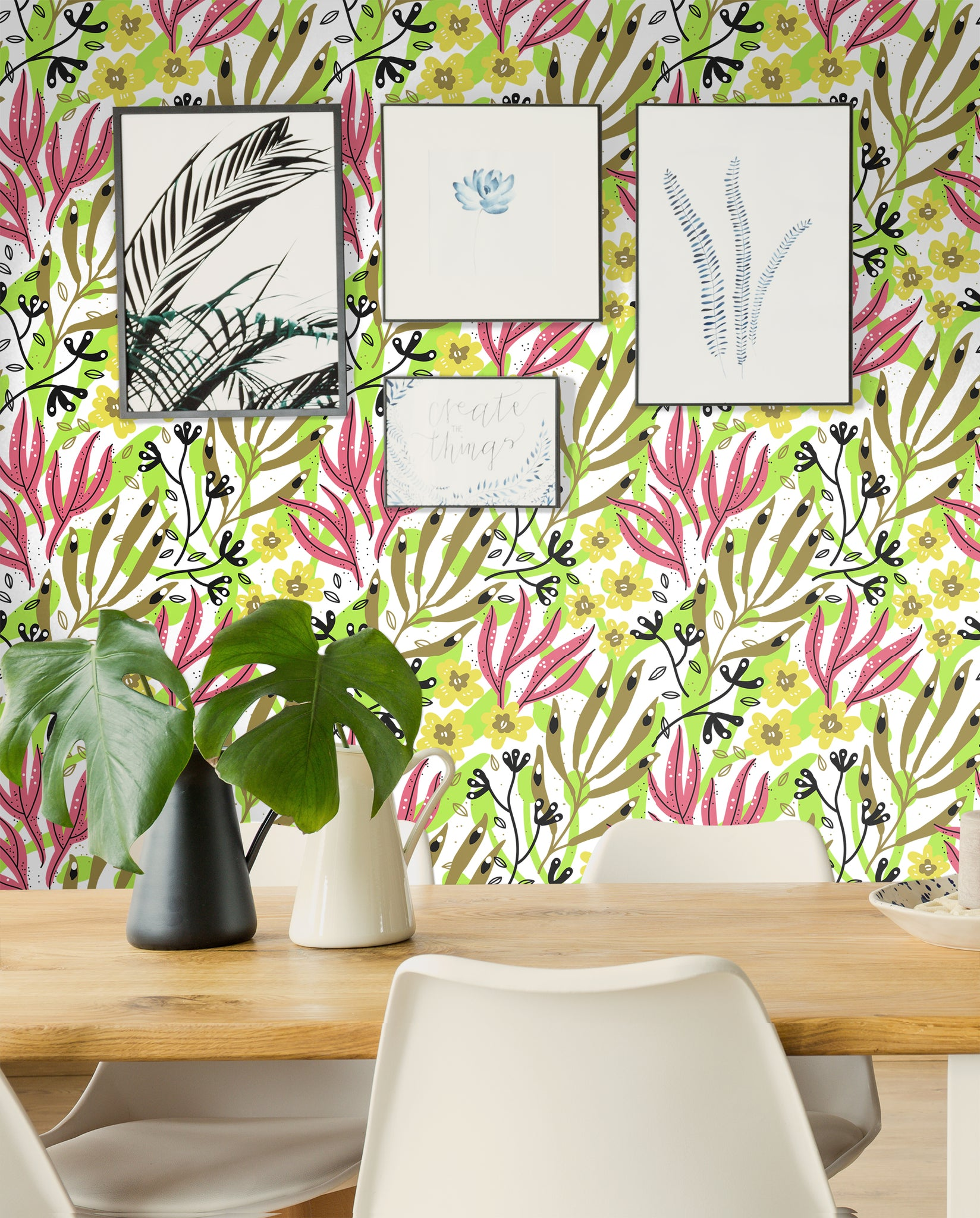 Brightly colored flower and plant removable wallpaper behind a birch dining room table with white chairs and framed pictures