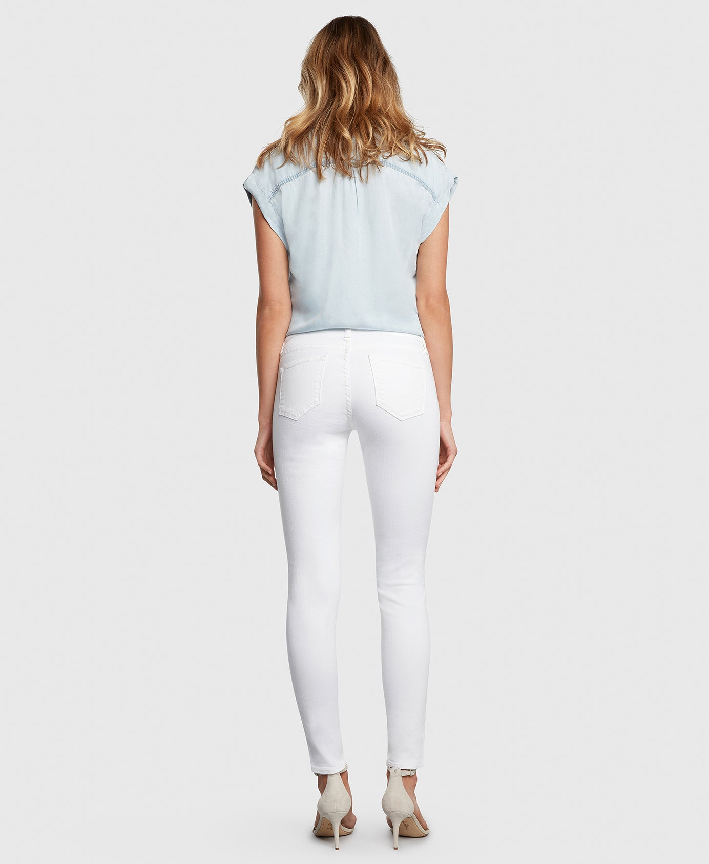 Principle DREAMER in White twill mid rise skinny jeans back