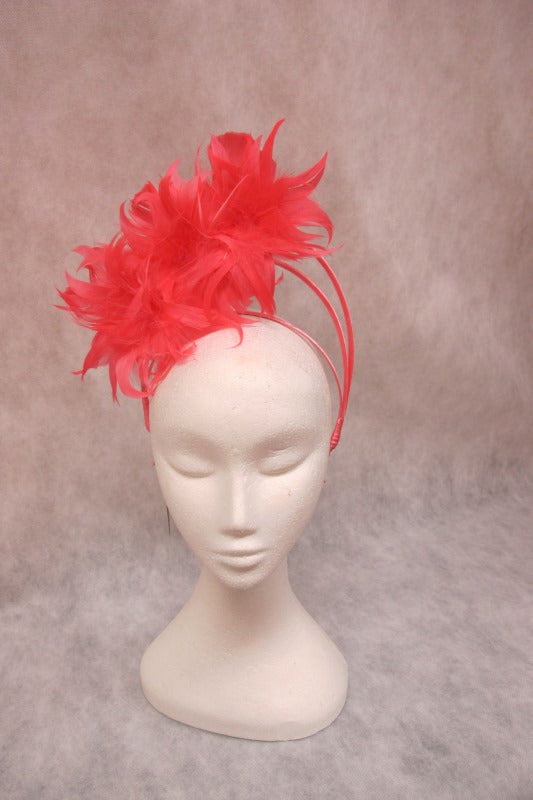 jendi fascinator in a coral finish