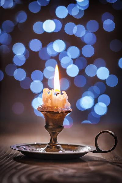 Example of Bokeh Photography - Candle against fairy lights.