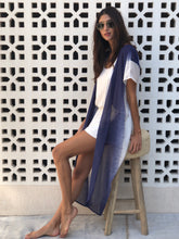 Blue and white kaftan worn by Brazilian model