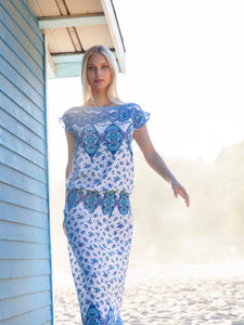 Blonde model in blue and white Menorca maxi dress