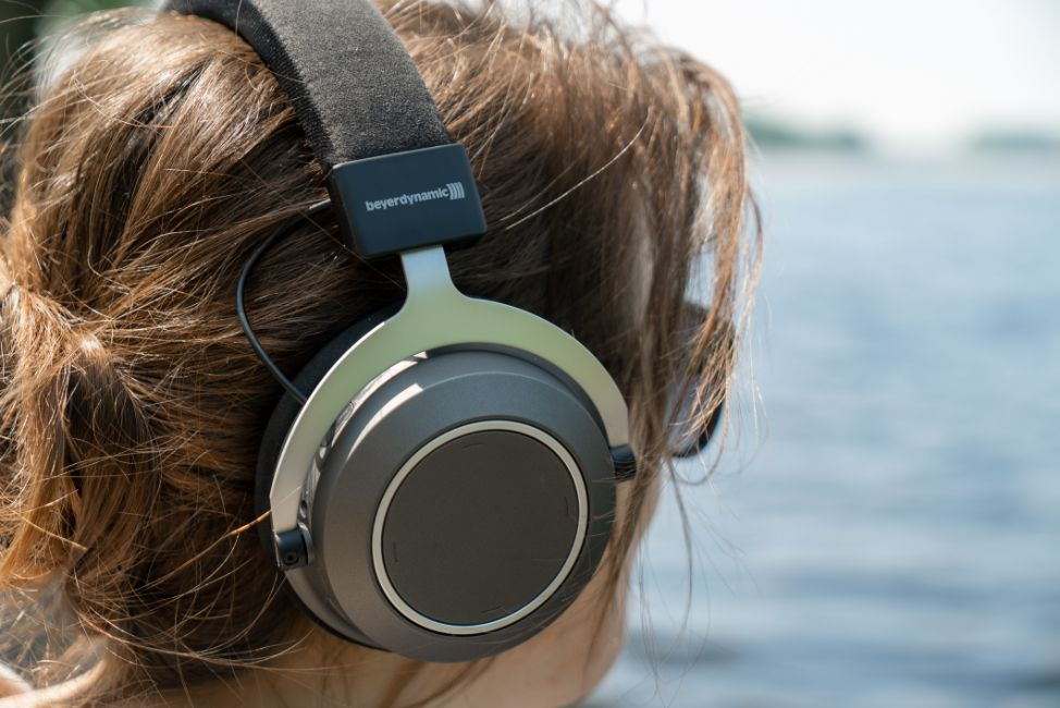 Girl wearing Bluetooth headphones, Photo by Mika Baumeister on Unsplash