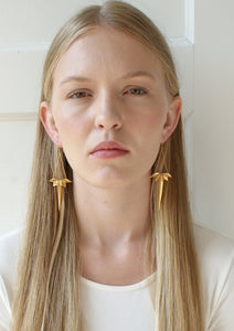Oblique star drop earrings