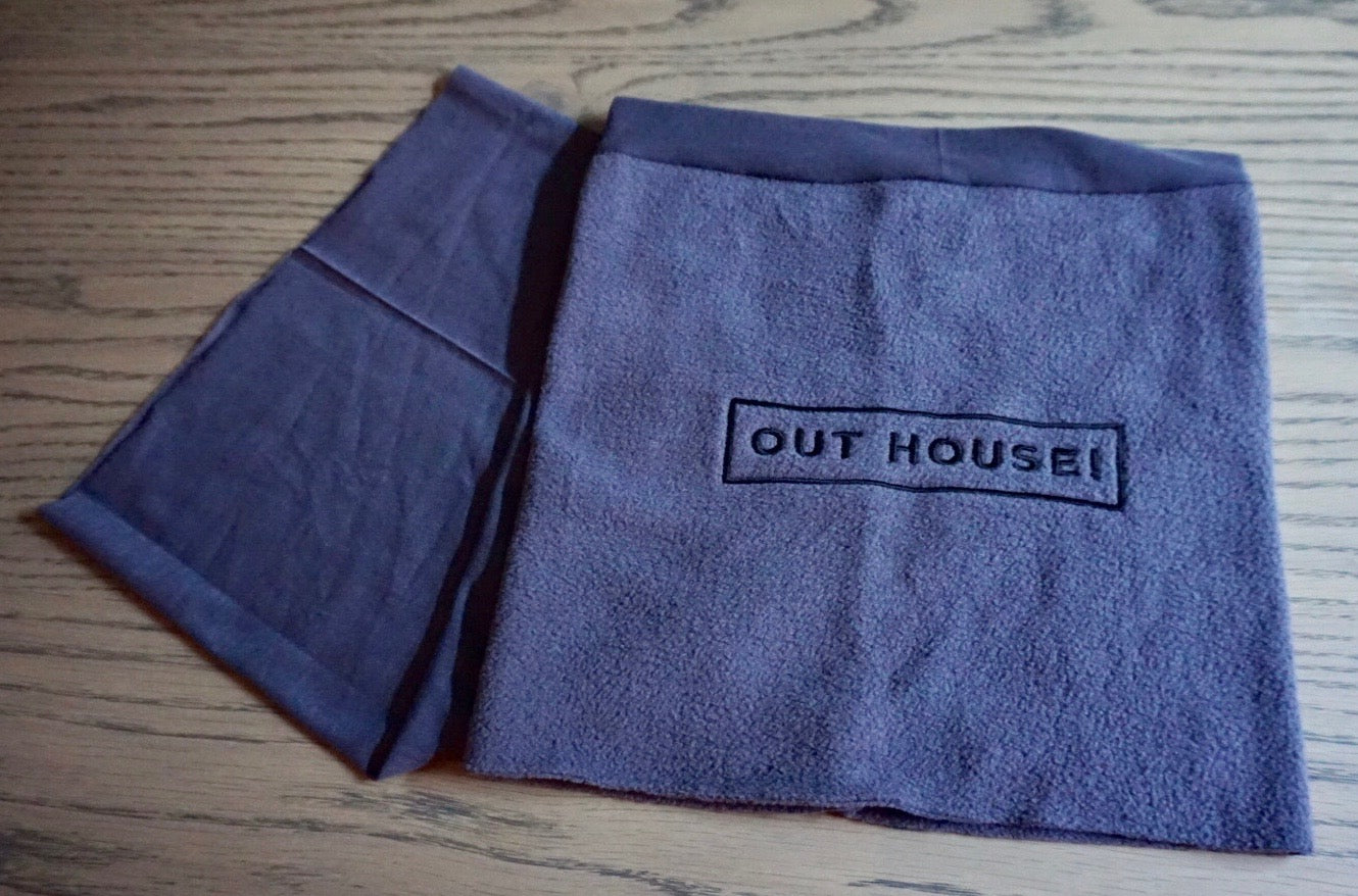 Grey Snood with black OUT HOUSE lettering embroidered on it