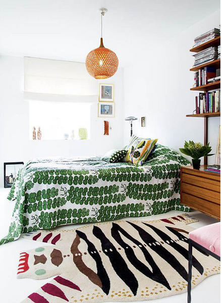 bed with green patterned comforter Photo credit: designlovefest