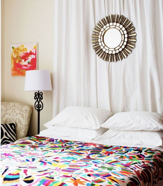 bed with colorful comforter Photo credit: Rue Mag