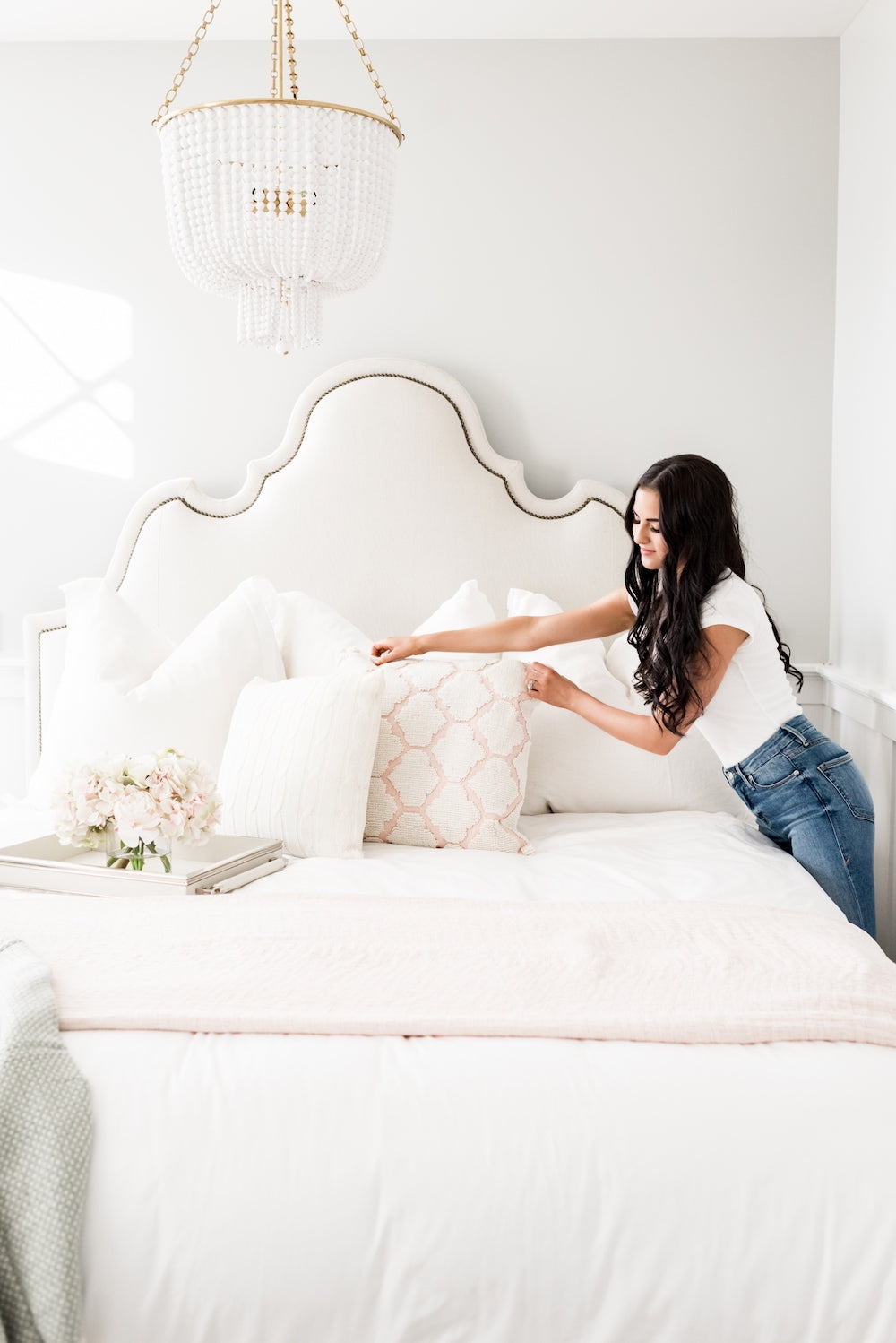 Rachel Parcell making her Modern Glam bed