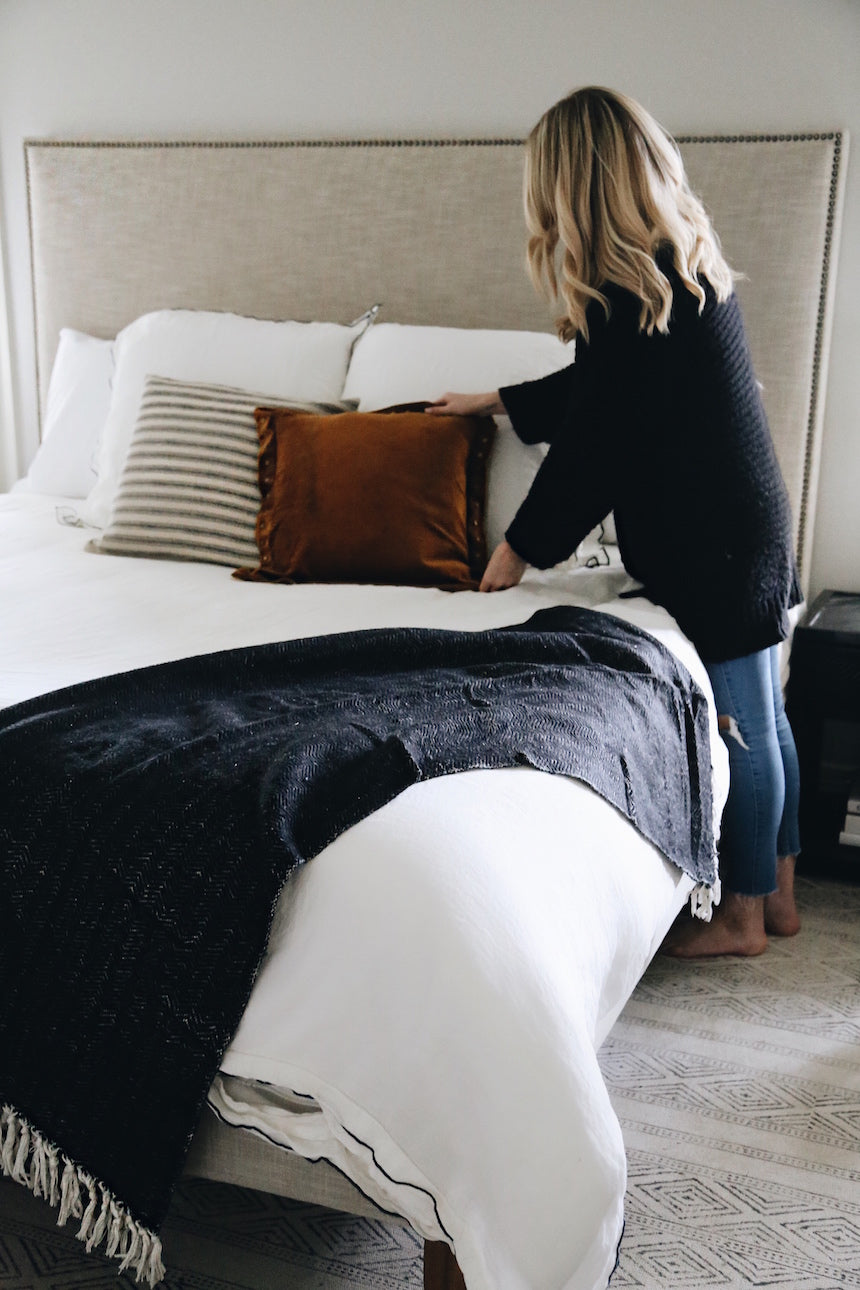 Blogger making guest room bed