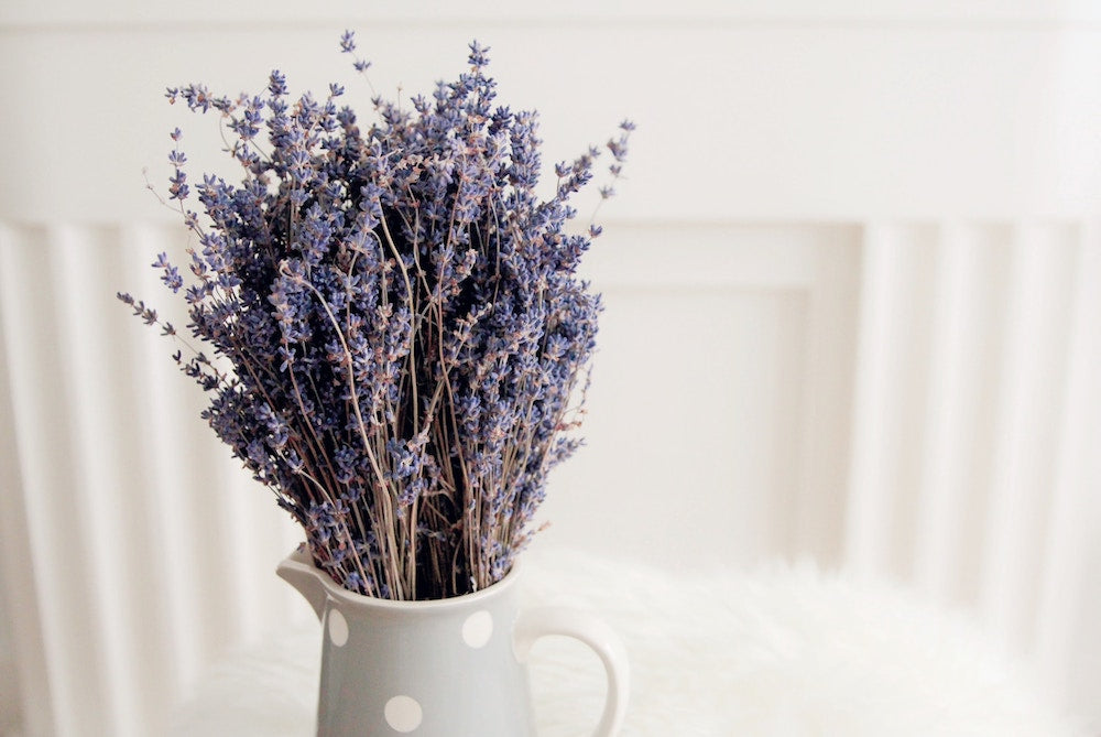 lavender flowers on a nightstand