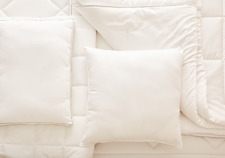 white pillows and comforter set