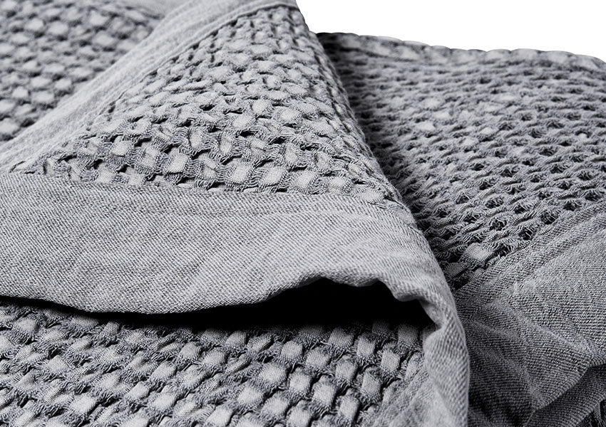 close up gray waffle weave blanket