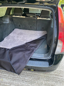 Reversible car boot dog mat with muddy Scrabbler flap