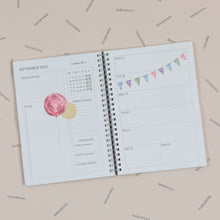 inside of a planner with an example of two pages per week option of calendar type