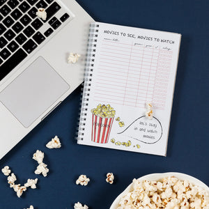 inside of a planner with an example of back sections - movies to see, movies to watch, popcorn watercolor drawing, rate movies you watch, filmi ki si jih moram ogledati, seznam filmov, ocena filma, a list of movies i have to see, movies i must see
