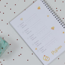 inside of a wedding planner, ring choosing, comparing and buying
