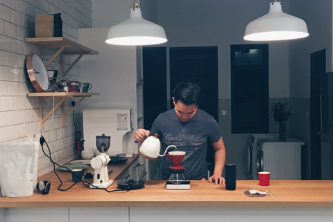 Master Barista Gideon brewing coffee