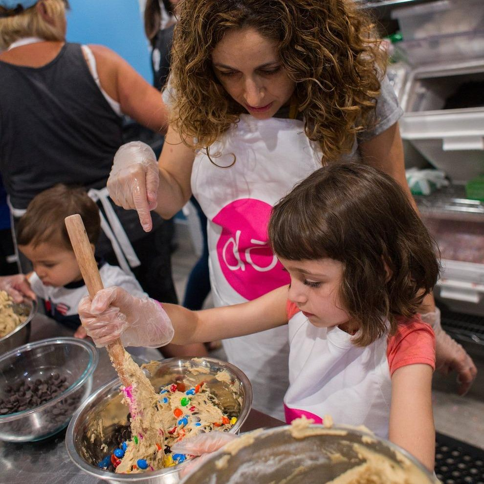 image of woman with child baking cookie dough