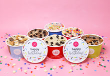 image of cookie dough containers with happy birthday lids