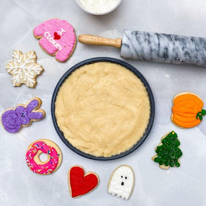 image of sugar cookie dough with cut out cookies