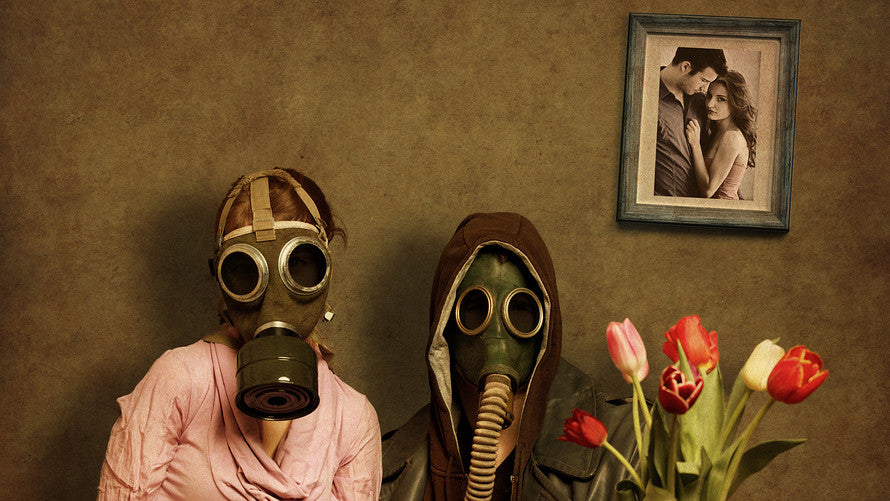 Husband and wife in gas masks