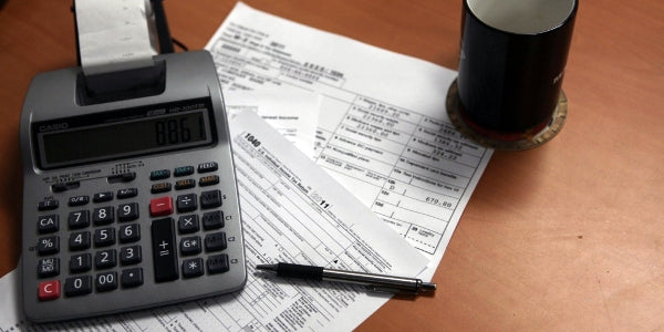 calculator and tax return on table