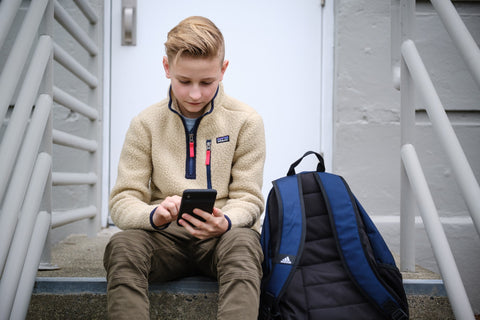 boy using zohmo iPhone battery case