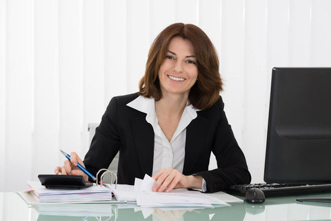 Smiling business woman at office