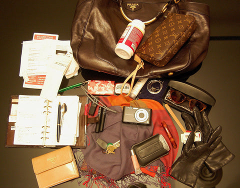 Purse contents laid out on table