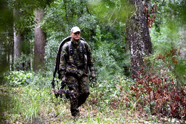 Male Hunter walking through the woods