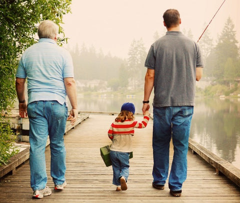 father son and grandfather walking on dock