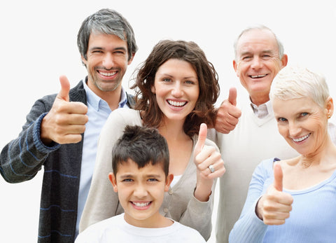 Happy people showing thumbs up sign