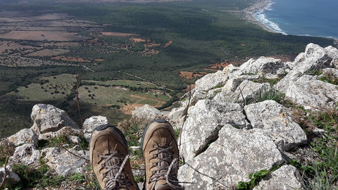 boots hanging over moutain