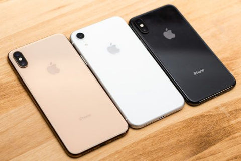 iPhone XS Max, iPhone XR, iPhone XS sitting on table