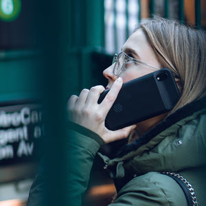 Woman on call with Iphone 8 battery case