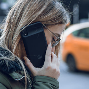 Woman on call with Iphone XR battery case