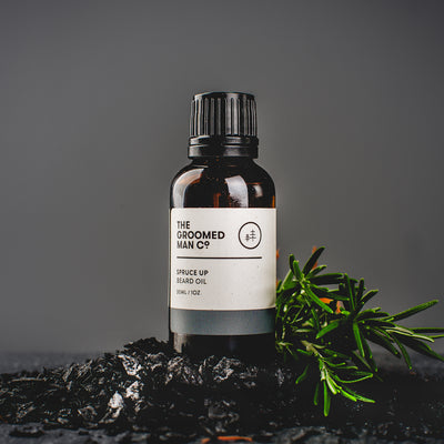 The Groomed Man Co. Spruce Up Premium Beard Oil on Top of Charcoal