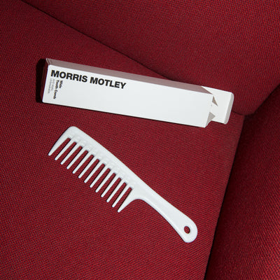 Morris Motley Wide Tooth Comb Hair Styling Tool and Box on Red Couch