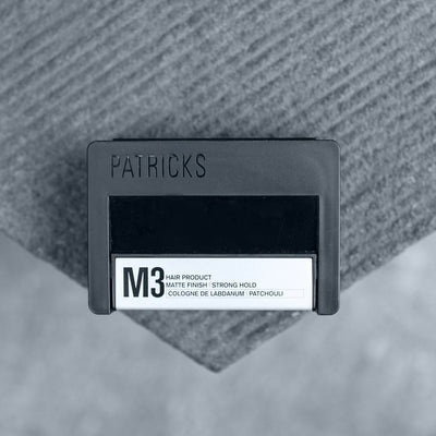Buy Patricks M3 Matte Strong Hold Hair Styling Pomade on Grey Fabric Top