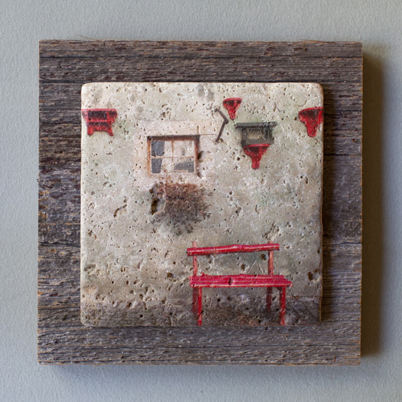 6inch by 6inch tectured trivet mounted on barn board