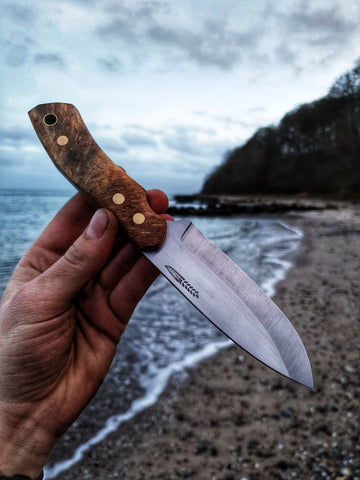 Bushcrafter o1-tool steel by the forest sea - Made in Denmark - Hvedegaard Knives - Dansk knivmager
