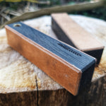 Shown here is the fine side of the double sided mini leather strop in bog oak. Hvedegaard Knives, quality handmade knives