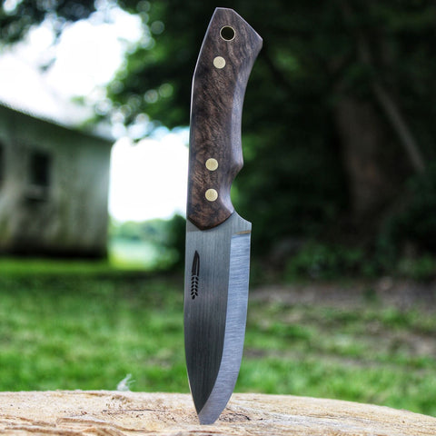 Bushcraft knife version 1, steel in rwl34 handle is made of turkish walnut class A, beautiful wooden grain structure. Pins in brass corby screws with a brass lanyard tube. Handmade knife for the outdoor life, made in Denmark