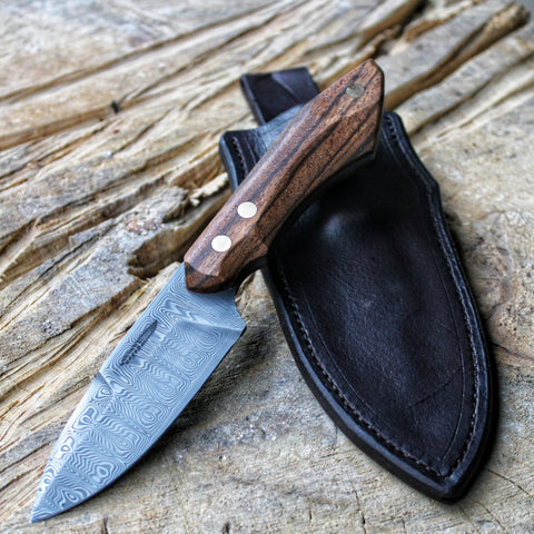 One of Hunting knife with Damasteel Odins Eye, Stabilized Zebrano wood, and a Leather Sheath