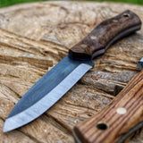 The Woodsman, made for your outdoor adventures, will patinate beautifully over time, as you experince more more of the great outdoor life. Made in Turkish walnut, and zebrano wood. Made in Denmark by young knife maker Mikkel Hvedegaard