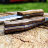 The new outdoor knife model from Hvedegaard Knives. The Woodsman. Made to be used, in the forest, around the campfire, or when prepping your camp meal. Made in o1 tool steel, matched with brass corby screws, and turkish walnut or zebrano wood. Comes in a nice leather sheath. Handmade Knife, made in Denmark.